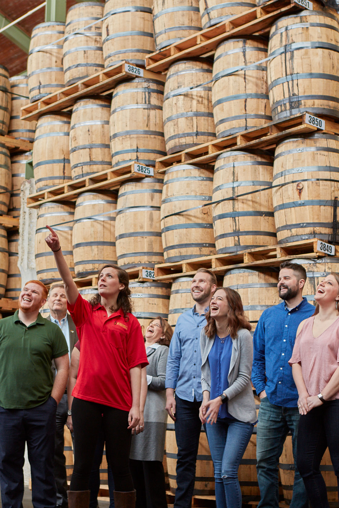 Tour group with tour guide pointing out a feature of the distillery